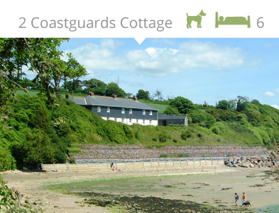 Coastguards cottages at low tide