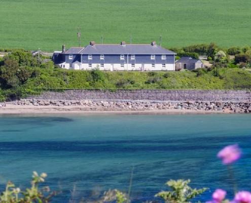Coastguards cottages at high tide