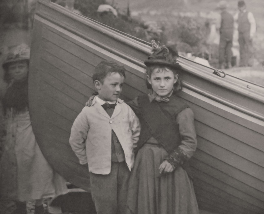 Victorian village children with a boat