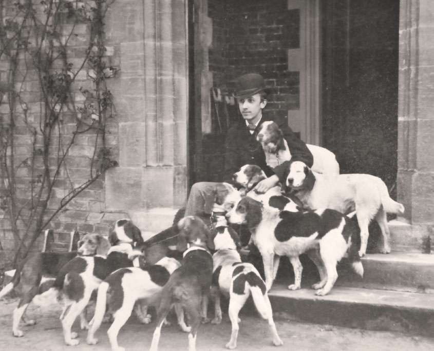 Frank Mildmay with hounds at Flete house