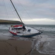 Yacht aground on Mothecombe beach