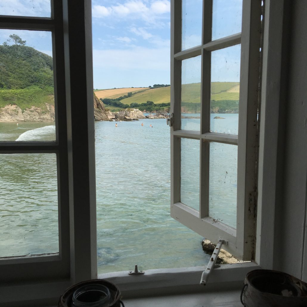 View of sea through window of Mothecombe Beach House