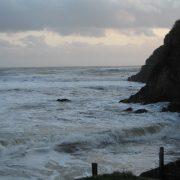 Waves crashing on Mothecombe Beach House